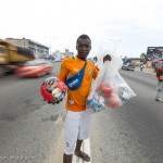 Street vendor in the road in Abidjan, Cote d'Ivoire
